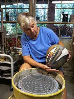 Ann Wallin on potters wheel - finished vase